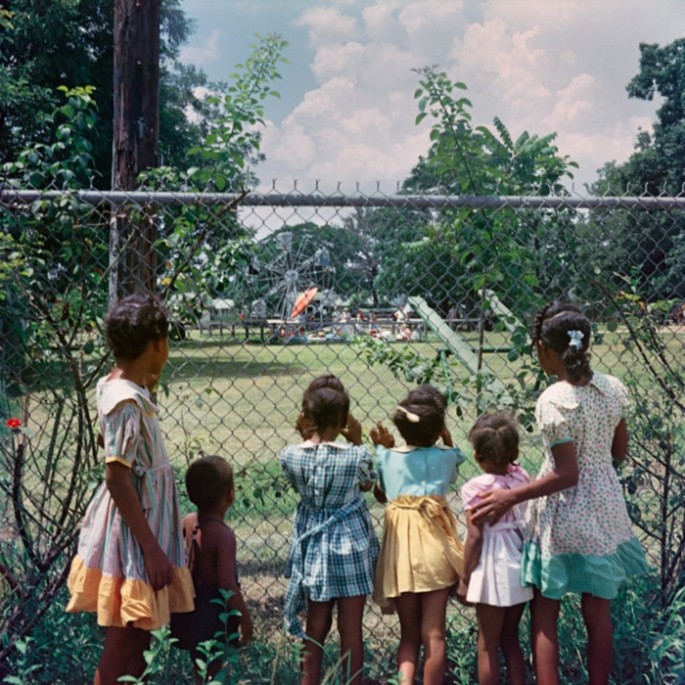 Black children looking in on a whites-only playground, Mobile, Alabama 1956