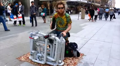 guy playing techno on pipes