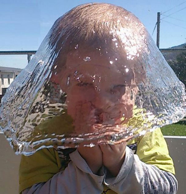 kid with water splashing on head