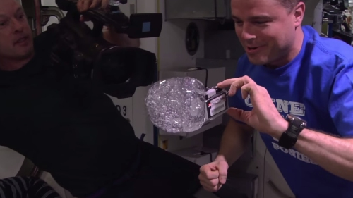 NASA Astronauts Put A GoPro Camera Inside A Large Water Bubble Floating In Space_121114s2