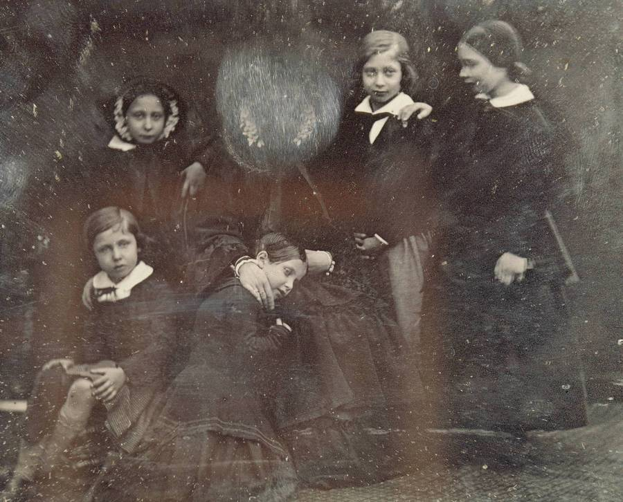 Queen Victoria with her children, 1852. She scratched off her own face personally, as she didn't like it.
