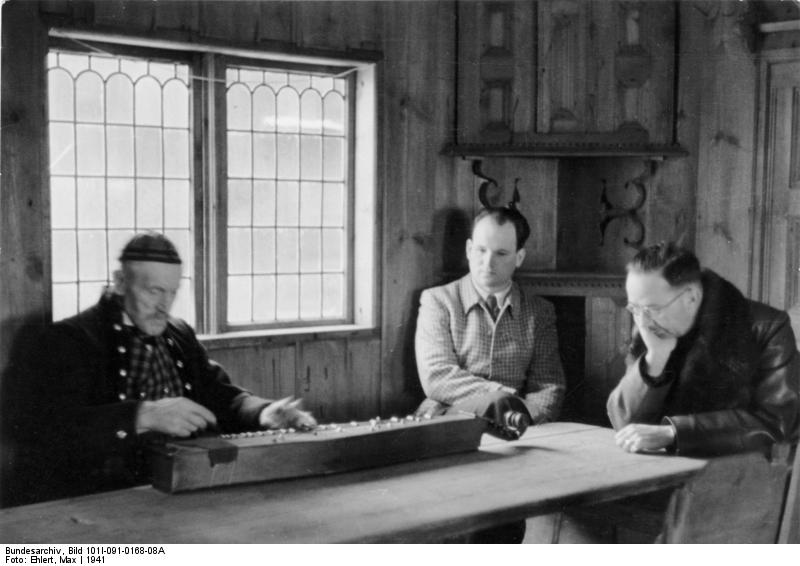 Heinrich Himmler listens to a Norwegian musician in his home, Norway 1941