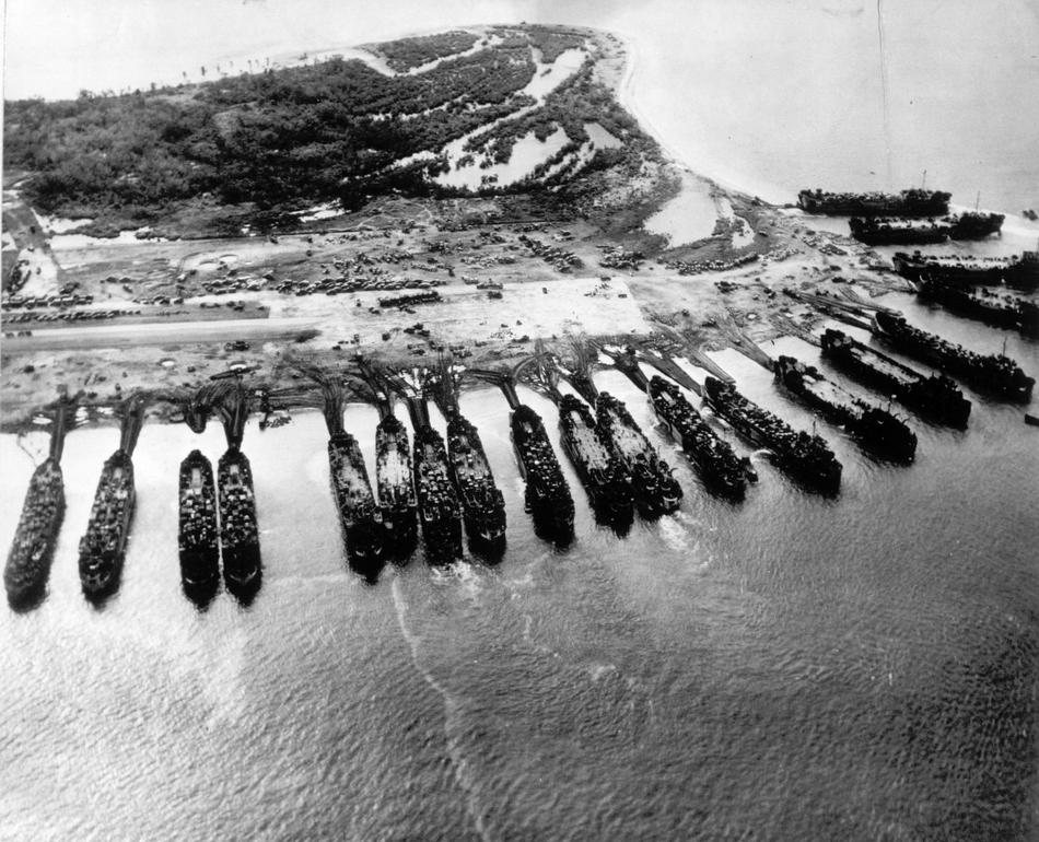 November 1944: U.S. landing ship tanks are seen from above as they pour military equipment onto the shores of Leyte island, to support invading forces in the Philippines. (AP Photo)