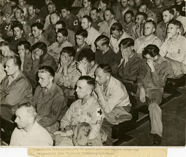 1945. German soldiers watching footage of concentration camps in 1945.
