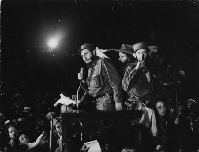1959. A dove landing on Fidel Castro's shoulder during an important speech. This landing has been the subject of much speculation, controversy, and worship. [January 8, 1959]