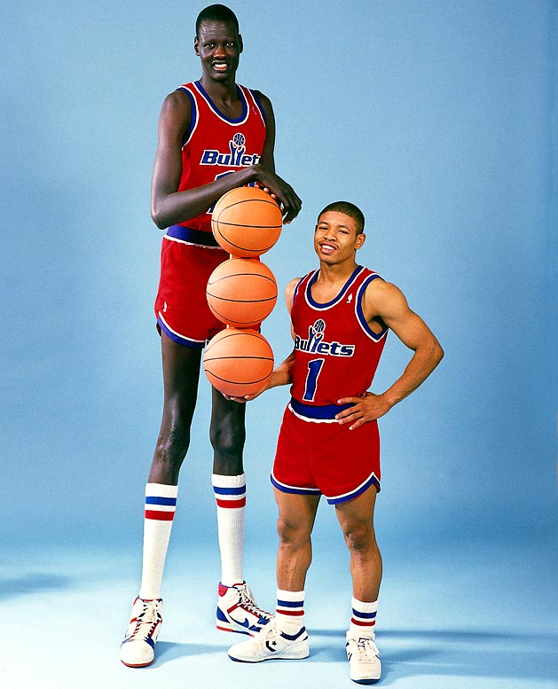 1987. Manute Bol and Muggsy Bogues, the tallest and shortest NBA players (both played in Baltimore Bullets)