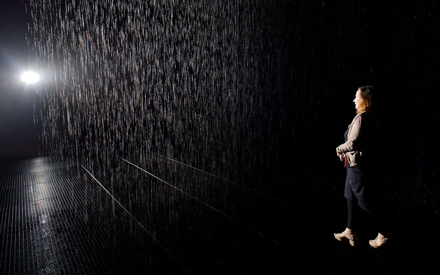A woman walks through an art installatio