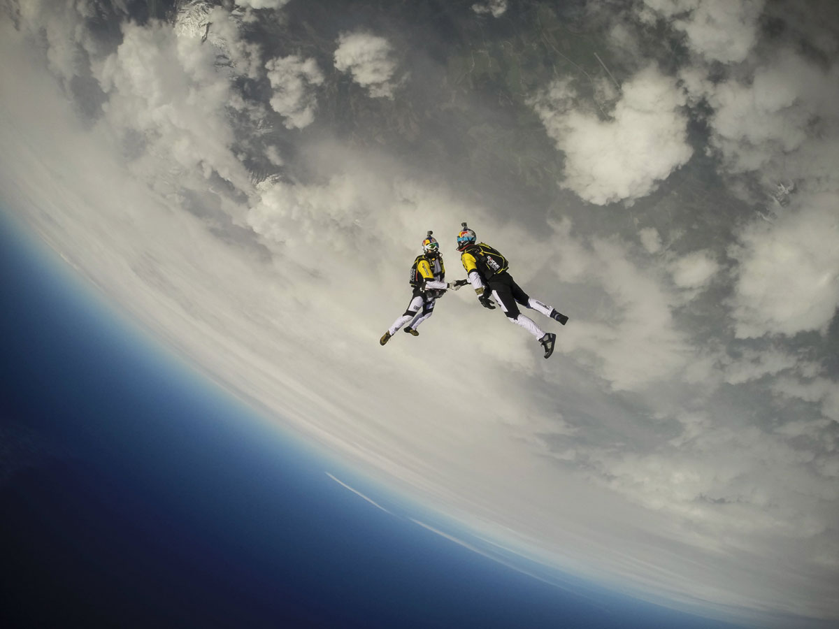skydivers-shaking-hands-mid-air