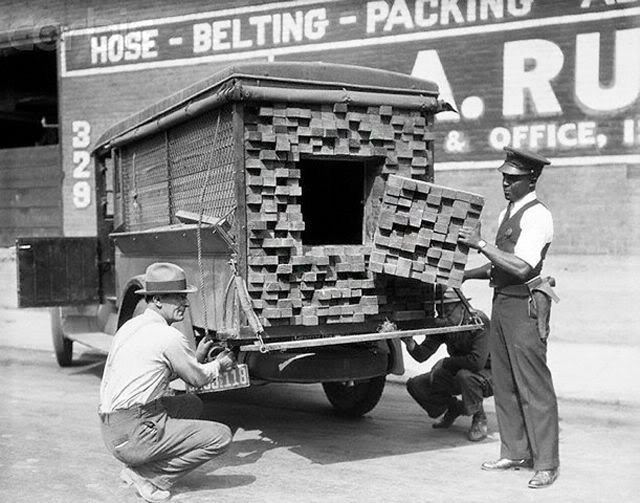 1926 A federal agent searching a wood truck during Prohibition