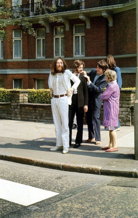 The Beatles Group are preparing for their famous crossing Abbey Road (1969)