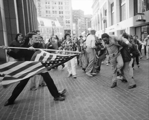 A man uses an American flag to assault civil rights activist 1976