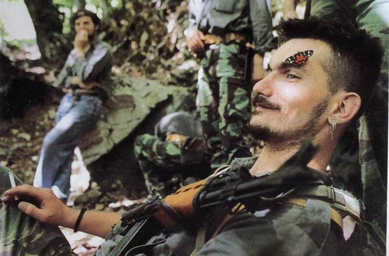 A Butterfly lands on the face of a resting Bosnian Serb soldier, near the Eastern Herzegovinia town of Konjic, 1995