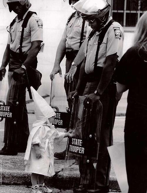 The-child-of-a-KKK-member-approaches-black-state-troopers1992