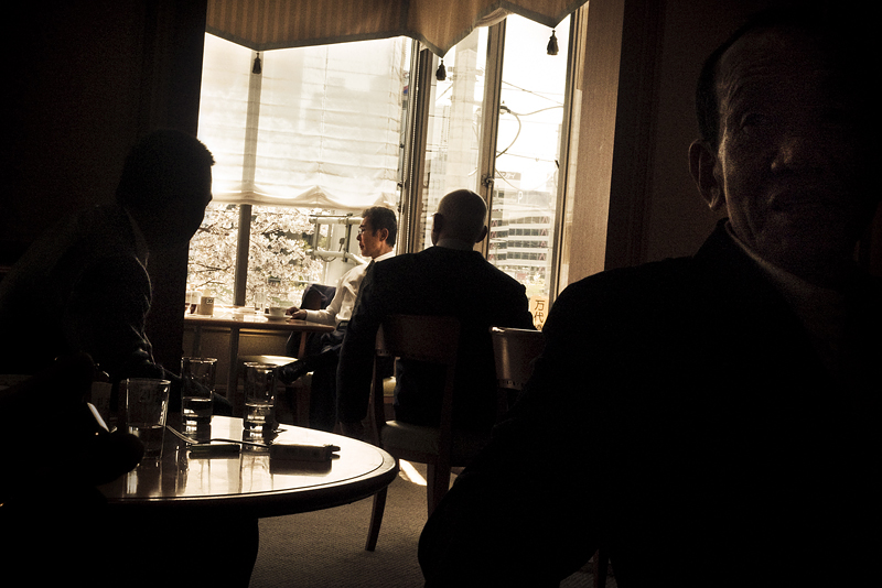 The two bosses highest in rank in the ODO family, having coffee at a hotel bar, after it has been completely cleared first, for safety reasons. Here they are flanked by several strategically positioned bodyguards - 2009
