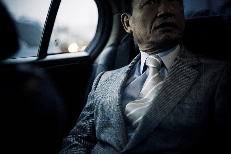 Nitto-san, Souichirou's direct boss, in the back of the car, while driving to Niigata prison to go and pick up two members of the family that are being released from prison that morning, after being incarcerated for several years - 2009