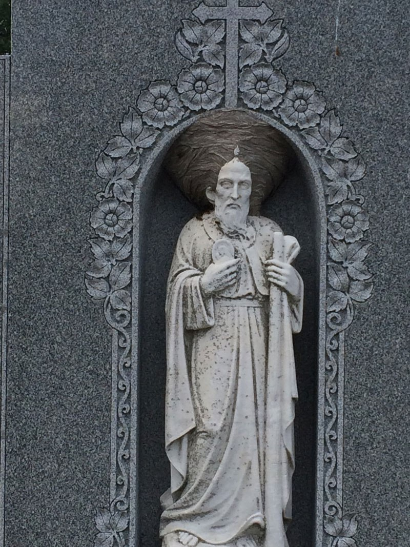 wasp nest makes statue of christian saint look like its wearing a turban