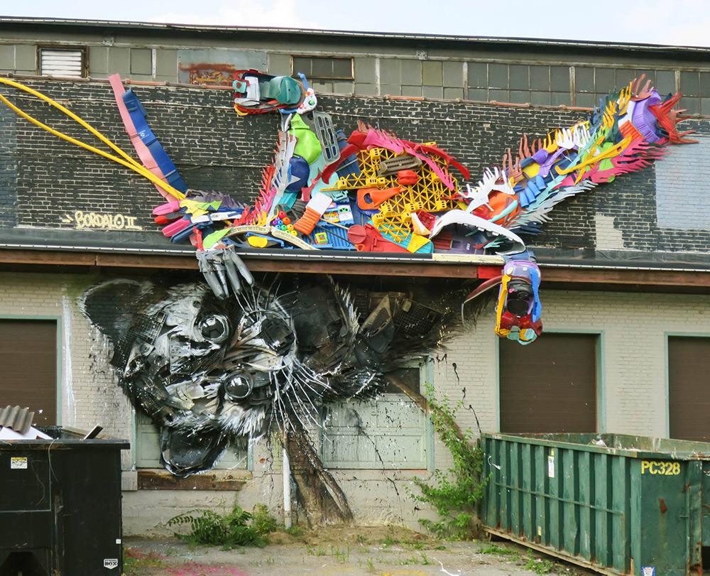 Bordalo II street art racoon