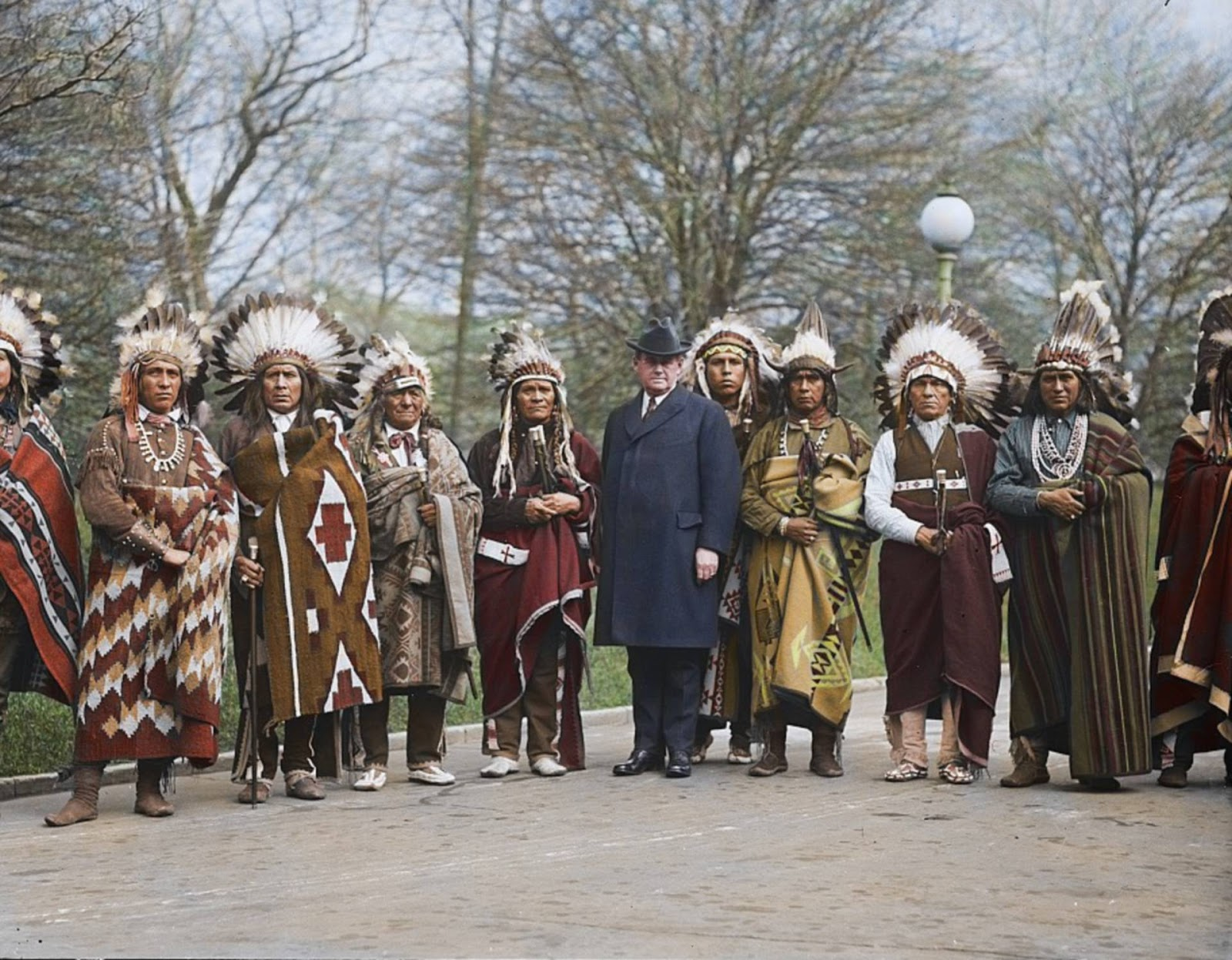 President Calvin Coolidge with a group of Native Americans on the White House lawn, 1924.